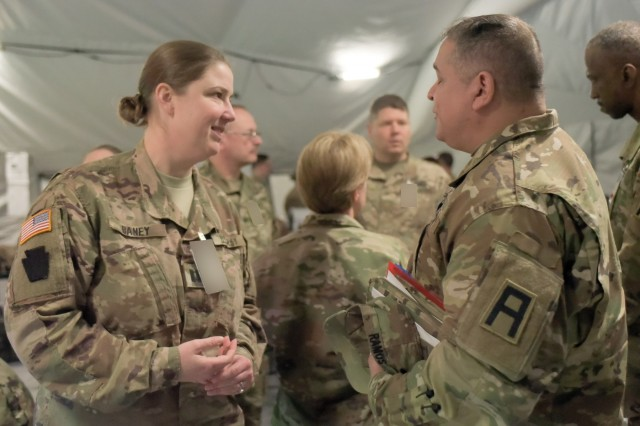 "Capt. Danielle Baney, the operational contract support officer in charge with the Pennsylvania Army National Guard's 28th Infantry Division, talks with Lt. Col. Efrain Ramos, First Army sustainment observer coach/trainer lead and the senior Army advisor for the New Jersey Army National Guard, during the 28th ID's culminating training exercise at Fort Hood, Texas, Jan. 29, 2018. About 500 Soldiers of the 28th ID Headquarters are preparing to deploy to the Middle East in support of Operation Spartan Shield.""(First Army personnel) have been very helpful answering questions we've had,"" said Baney, who is deploying for the second time with the 28th ID; she served in Kuwait with the unit in 2012-3.(Photo altered for security purposes.)"