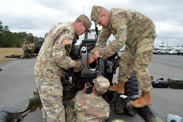 Cannon crewmembers assigned to Battery B, 2nd Battalion, 11th Field Artillery Regiment, 25th Division Artillery, 25th Infantry Division, ensure a breach block of a M119A3 howitzer is properly installed at Fort Polk, Louisiana, on Feb. 6, 2018. Soldiers assigned to the 25th Infantry Division are participating in an annual rotation at the Joint Readiness Training Center. (U.S. Army photo by Staff Sgt. Armando R. Limon, 3rd Brigade Combat Team, 25th Infantry Division)