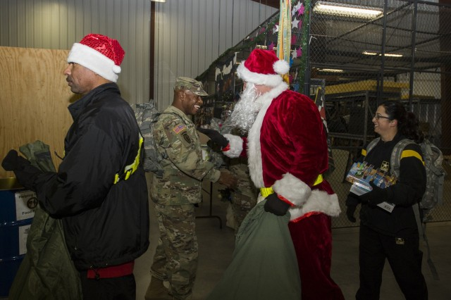 4th Cavalry Multi-Functional Training Brigade Soldiers donate gifts to the Red Cross Santa's Workshop program Nov. 22, 2017, at the Red Cross warehouse on Fort Knox, Ky. The donated gifts are used by the Red Cross to provide parents an opportunity to shop for Christmas at no cost. (U.S. Army photo by Sgt. Rakeem Carter.)