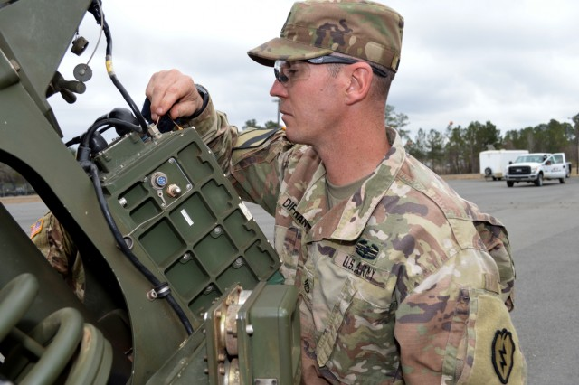 Staff Sgt. Michael Difrancia, a cannon section chief assigned to Battery B, 2nd Battalion, 11th Field Artillery Regiment, 25th Division Artillery, 25th Infantry Division, inspects the connections of a M119A3 howitzer at Fort Polk, Louisiana, on Feb. 6, 2018. Soldiers assigned to the 25th Infantry Division are participating in an annual rotation at the Joint Readiness Training Center. (U.S. Army photo by Staff Sgt. Armando R. Limon, 3rd Brigade Combat Team, 25th Infantry Division)