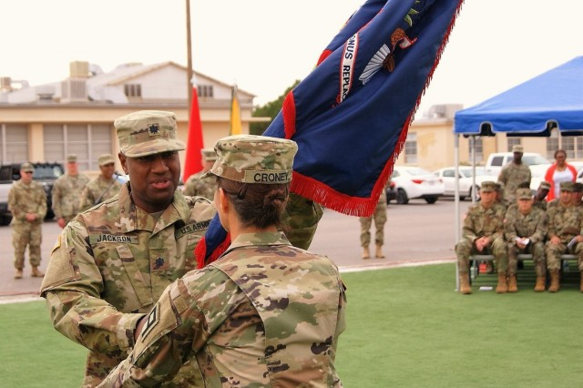(Left) Lt. Col. Adrian Jackson, incoming commander of the 7th Personnel Service Battalion, 95th Regiment, 4th Brigade, 94th Training Division, hands the CONUS Replacement Center guidon to Command Sgt. Maj. Shannon Croney, command sergeant major of the 7th PS Battalion, at the Transfer of Authority ceremony held at Fort Bliss, Texas, Dec. 1, 2017.