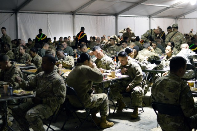 Soldiers eating breakfast served up by culinary specialist assigned to the 25th Infantry Division at Fort Polk, Louisiana, on Feb. 6, 2018. Soldiers assigned to the 25th Infantry Division and 8th Theater Sustainment Command are participating in an annual rotation at the Joint Readiness Training Center. (U.S. Army photo by Staff Sgt. Armando R. Limon, 3rd Brigade Combat Team, 25th Infantry Division)