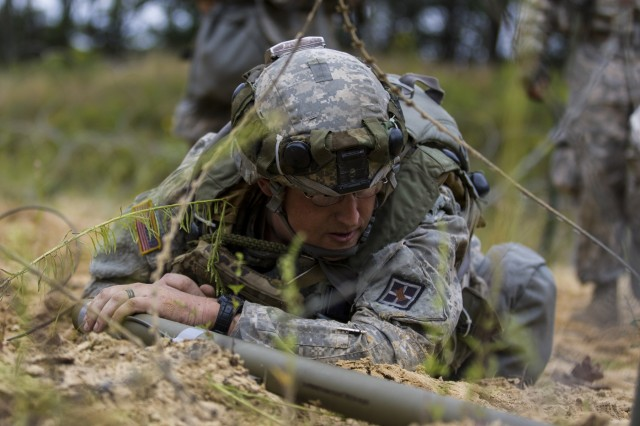 Soldiers assigned to the 396th Engineer Company, Mobility Augmentation Company, out of Ashland, KY, low crawl toward a barbed wire barrier to destroy it with a bandolier explosive charge as a part of their training during Combat Support Training Exercise 86-17-02 Aug. 17, 2017, on Fort McCoy, WI. CSTX is a 181st Infantry Brigade led, 4th Cavalry Multi-Functional Training Brigade supported exercise designed to assist combat-service and combat-service-support units in planning, preparing, supervising and executing of pre-mobilization collective training. (U.S. Army photo by Sgt. Rakeem Carter)