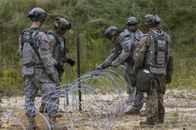 Soldiers assigned to the 396th Engineer Company, Mobility Augmentation Company, out of Ashland, KY, set Constantine wire in place to form a barbed wire barrier as part of their training during Combat Support Training Exercise 86-17-02 Aug. 17, 2017, on Fort McCoy, WI. CSTX is a 181st Infantry Brigade led, 4th Cavalry Multi-Functional Training Brigade supported exercise designed to assist combat-service and combat-service-support units in planning, preparing, supervising and executing of pre-mobilization collective training. (U.S. Army photo by Sgt. Rakeem Carter)