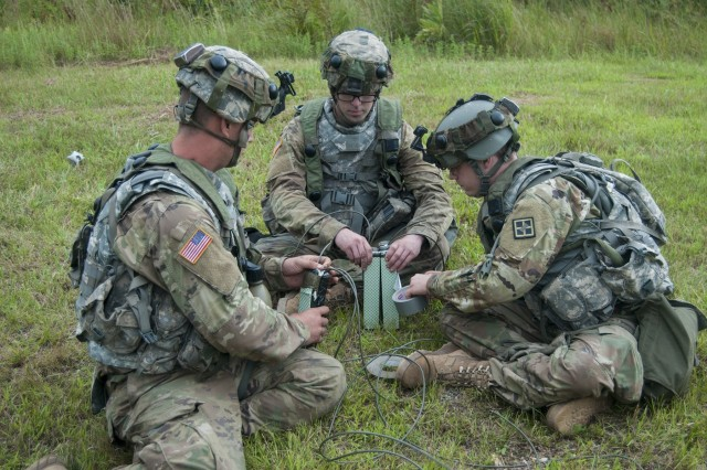 Spc. Stephen Knoff, left, Pvt. Jon Mauk, center, and Pvt. Matthew Hamilton, all assigned to 396th Engineer Company, Mobility Augmentation Company, bond a 7-and-a-half-pound block of C4 in preparation to detonate it as part of their training during Combat Support Training Exercise 86-17-02 Aug. 17, 2017, on Fort McCoy, WI. CSTX is a 181st Infantry Brigade led, 4th Cavalry Multi-Functional Training Brigade supported exercise designed to assist combat-service and combat-service-support units in planning, preparing, supervising and executing of pre-mobilization collective training. (U.S. Army photo by Sgt. Rakeem Carter)