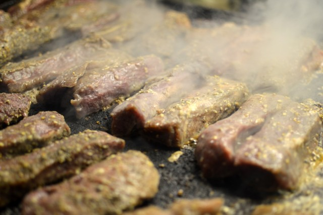 Breakfast steaks being cooked by culinary specialists assigned to the 3rd Battalion, 7th Field Artillery Regiment, 25th Division Artillery, 25th Infantry Division, at Fort Polk, Louisiana, on Feb. 6, 2018. Soldiers assigned to the 25th Infantry Division are participating in an annual rotation at the Joint Readiness Training Center. (U.S. Army photo by Staff Sgt. Armando R. Limon, 3rd Brigade Combat Team, 25th Infantry Division)