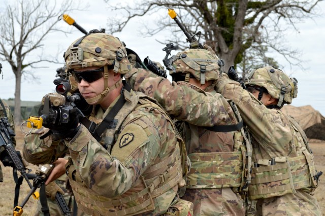 Infantrymen assigned to Company A, 2nd Battalion, 35th Infantry Regiment, 3rd Brigade Combat Team, 25th Infantry Division, ready themselves prior to simulating a room clearing scenario at Fort Polk, Louisiana, on Feb. 5, 2018. The 3rd BCT is participating in a rotation at the Joint Readiness Training Center. (U.S. Army photo by Staff Sgt. Armando R. Limon, 3rd Brigade Combat Team, 25th Infantry Division)