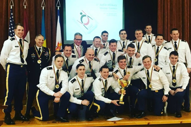 U.S. Army Maj. Michael Long (upper row, center) and his All Army Hockey teammates pose for a photo with their gold medals in Vilnius, Lithuania, Jan. 26. Long scored the game-winning goal in the final match versus the host nation to claim gold for the U.S. in the Fifth Baltic Military Winter Games Ice Hockey Tournament.
