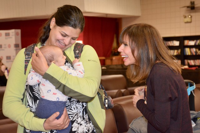 Sutapa Harney and son, Nicholas, visits with Heidi Murkoff at the USO baby shower Monday.