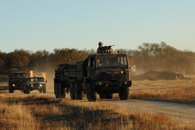 Soldiers from 1st Battalion, 37th Field Artillery Regiment, convoy to a staging area just before sunset during Bayonet Focus 18-02 at Fort Hunter Liggett, Calif., Feb. 6, 2018. Bayonet Focus 18-02 the capstone training environment design emphasizes individual and collective Soldier skills against an adaptable force in an austere and fluctuating environment.  (U.S. Army photo by Staff Sgt. Kenneth Burkhart, 302nd Mobile Public Affairs Detachment)
