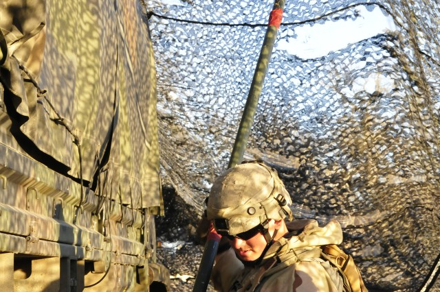 Soldier from 1st Battalion, 37th Field Artillery Regiment, adjust the height of their camouflage netting around a 155-mm Howitzer team during Bayonet Focus 18-02 at Fort Hunter Liggett, Calif., Feb. 6, 2018. Bayonet Focus 18-02 the capstone training environment design emphasizes individual and collective Soldier skills against an adaptable force in an austere and fluctuating environment.  (U.S. Army photo by Staff Sgt. Kenneth Burkhart, 302nd Mobile Public Affairs Detachment)