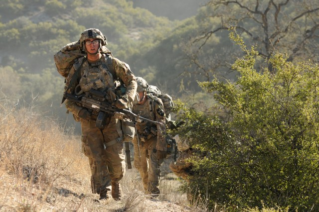 A 5th Battalion, 20th Infantry Regiment, Soldier rucks up a hill during exercise Bayonet Focus 18-02 at Fort Hunter Liggett, Calif., Feb. 8, 2018. The 7th Infantry Division returned for the first time since 1994 to Fort Hunter Liggett for Bayonet Focus 18-02, an exercise designed to test the individual and collective training proficiency and readiness in an austere and fluctuating training environment provided by Fort Hunter Liggett.  (U.S. Army photo by Staff Sergeant Kenneth D. Burkhart, 302nd Mobile Public Affairs Detachment)