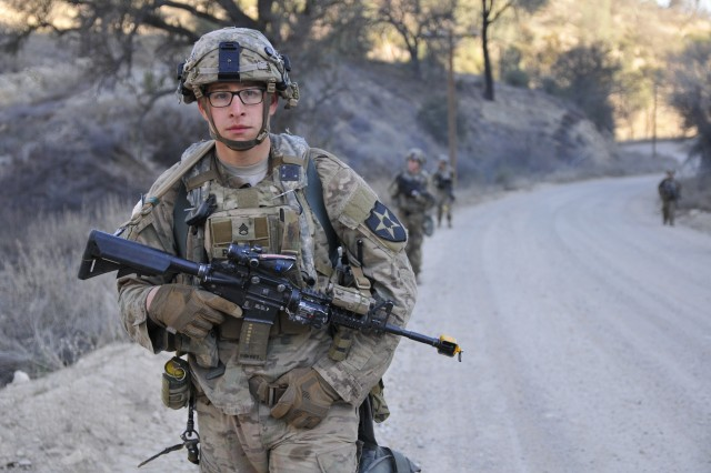 A 5th Battalion, 20th Infantry Regiment, Soldier pauses during a ruck march during exercise Bayonet Focus 18-02 at Fort Hunter Liggett, Calif., Feb. 8, 2018. The 7th Infantry Division returned for the first time since 1994 to Fort Hunter Liggett for Bayonet Focus 18-02, an exercise designed to test the individual and collective training proficiency and readiness in an austere and fluctuating training environment provided by Fort Hunter Liggett.  (U.S. Army photo by Staff Sergeant Kenneth D. Burkhart, 302nd Mobile Public Affairs Detachment)