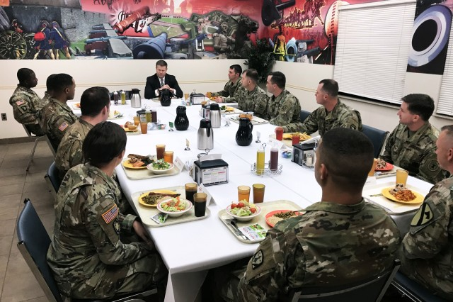 Soldiers attending the Noncommissioned Officer Academy have lunch with Under Secretary of the Army Ryan McCarthy, Feb. 6, 2018, at Fort Sill, Okla.