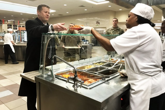 Under Secretary of the Army Ryan McCarthy receives his lunch at the Staff Sgt. Juan Garcia Dining Facility, Feb. 6, 2018, during a visit to Fort Sill, Okla.