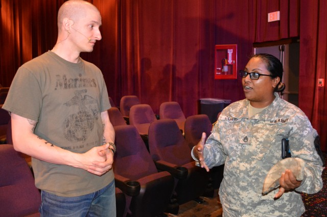 Staff Sgt. Savita Curtis, 1st Cav. Division, discusses the show's impact with actor Christopher Boucher who plays Marine Cpl. AJ Czubai in the 60-minute multimedia production depicting war and its impact on Soldiers and their Families.