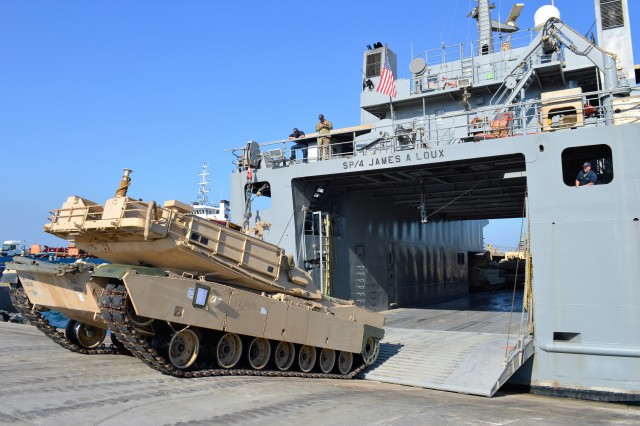 180112-A-RW053-099 MUGHARAG, United Arab Emirates -- U.S Army soldiers from the 335th Transportation Detachment assist in unloading a M1 Abrams tank from the U.S. Army Logistics Support Vessel, SP/4 James A Loux, at Mugharag Port January 08, 2018. (U.S. Army photo by Sgt. 1st Class Charles Highland)