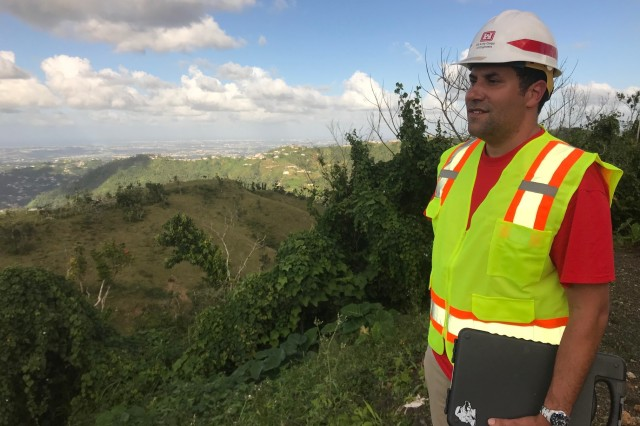 NARANJITO, Puerto Rico -- Victor Otero, a reality specialist, surveys land Feb. 8 in municipalities surrounding San Juan, Puerto Rico. Victor Otero is a U.S. Army Corps of Engineer Reality Specialist from the Galveston District.