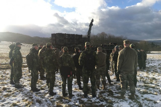 Participants learn about Patriot launching station and missile reload operations from a Patriot crewmember assigned to Bravo Battery, 5th Battalion, 7th Air Defense Artillery on Smith Barracks, Baumholder Jan. 18, 2018. (Photo by 1st Lt. Benjamin E. Schiff, 5-7 ADA)