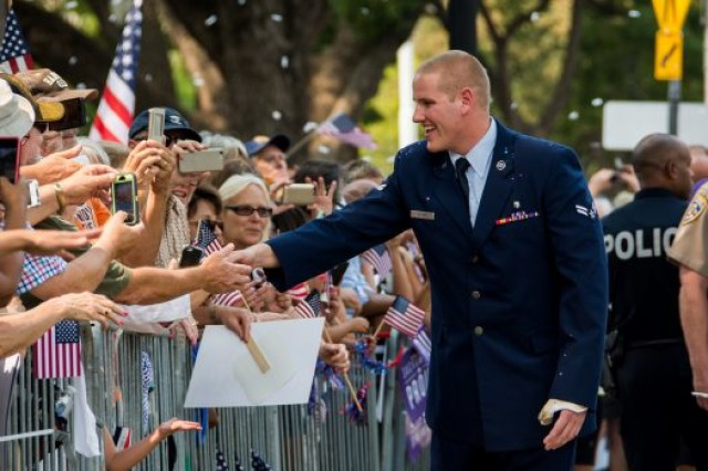 Air Force Airman 1st Class Spencer Stone is greeted with a hero's welcome during the Sacramento Hometown Heroes Parade and festivities at the State Capital building in downtown Sacramento, Calif., Sept. 11, 2015.