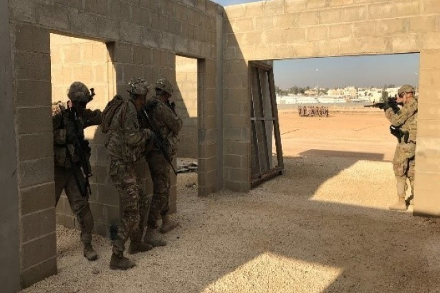 "Soldiers from Bravo Company ""Bushmasters,"" 1st Battalion, 184th Infantry Regiment, California Army National Guard, prepare to enter and clear a room during a training exercise near Amman, Jordan on January 3, 2018."