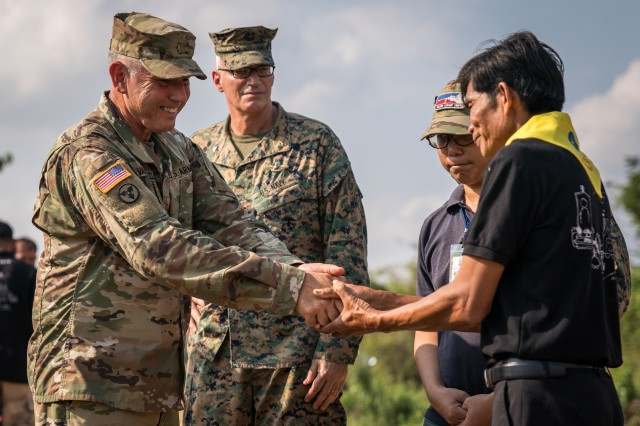 Ban Na Isan Village Chief Arun Sopaporn (right) thanks U.S. Army Maj. Robert Vandertuin, the head of a Combined Joint Civil Military Operations Task Force, for visiting in Chachoengsao, Kingdom of Thailand, Jan. 31, 2018. Both Royal Thai and U.S. Armed Forces observed the efforts being made by the villagers to prevent future elephant stampedes and donated several bags of rice and potatoes to the village. Exercise Cobra Gold 2018 is an annual exercise conducted in the Kingdom of Thailand and runs from Feb. 13-23 with up to nine full participating nations.