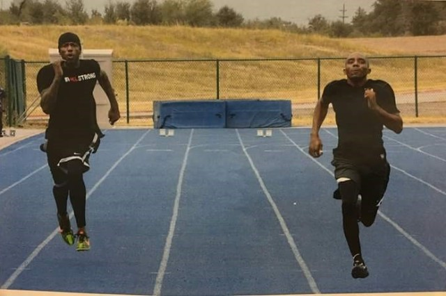 Sgt. Craig Netter (right) sprints against his friend and track team member Army veteran Adam Blow at Fort Bliss Trials in 2016.