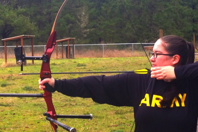 Spc. Katherine Morrin begins target practice at the Warrior Transition Battalion at Joint Base Lewis-McChord's Ryan J. Peterson's archery range.