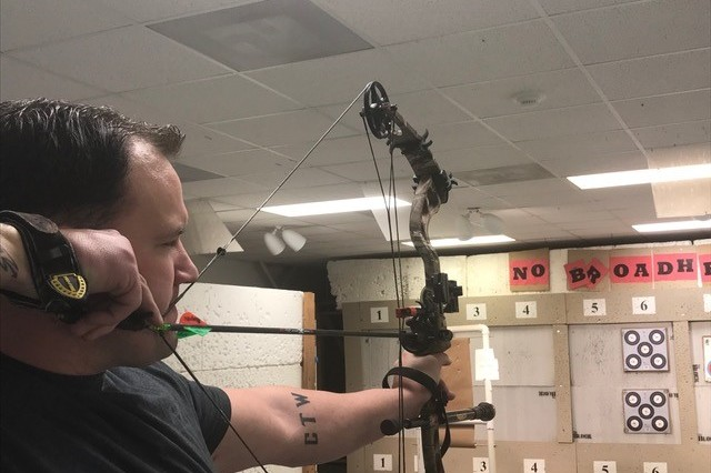 Staff Sgt. Ross Alewine trains at Ft. Belvoir, Va. archery range preparing for the 2018 Army Trials.