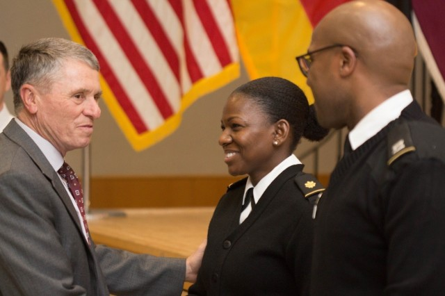Retired Brig. Gen. William T. Bester, former chief of the Army Nurse Corps, presents coins to Maj. Jennifer Y. Givens and Capt. Marqus O. Berry, Landstuhl Regional Medical Center Clinical Nurse Educator and LRMC Registered Nurse, respectively, during the LRMC 2018 Army Nurse Corps birthday celebration, Feb. 2, 2018.