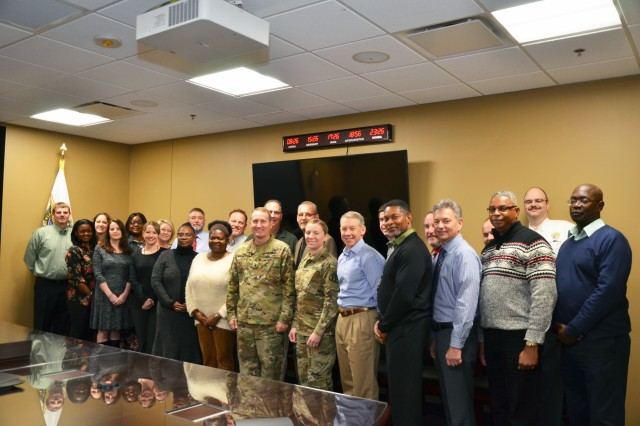 Brig. Gen. Thomas Todd, PEO Aviation, (center) is pictured with the entire Fixed Wing team working the EMARSS program.  The team consists of personnel from Fixed Wing's EMARSS program and business division, and the Army Contracting Command-Redstone.