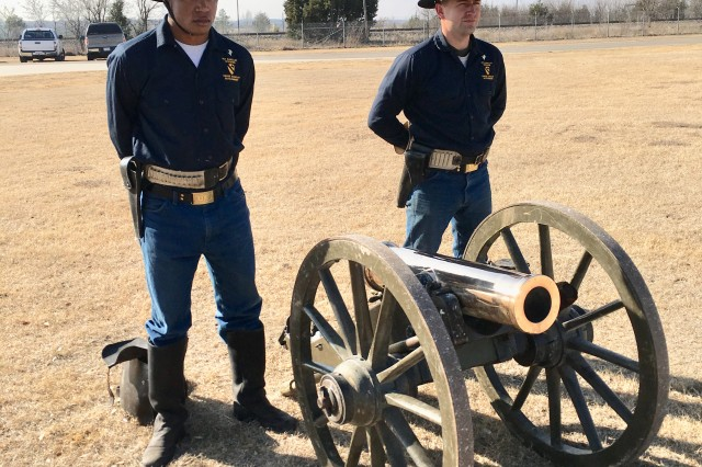 Horse Platoon Troopers Spc. Glenn Morrison (left), and Spc. William Stoner, stand by ready to fire an 1842 Light Mountain Howitzer (cannon) during a Florence, Texas Elementary School visit to the 1st Cavalry Division Horse Cavalry Detachment�under Fort Hood's Adopt-A-School program Thursday.