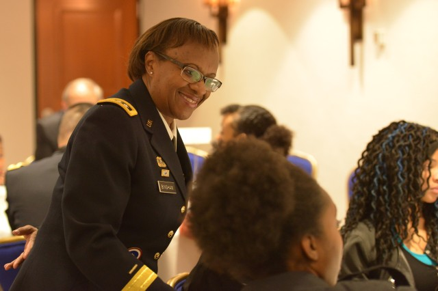Lt. Gen. Gwen Bingham, assistant chief of staff for Installation Management, speaks with high school students during a mentoring session at the 32nd annual BEYA conference Feb. 9 in Washington, D.C. About 140 Army senior leaders mentored 350 students during the Stars and Stripes mentoring program.