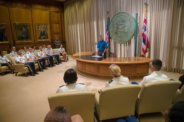 State of Hawai'i Governor David Ige presents a proclamation statement with staff members of the Tripler Army Medical Center Army Nurse Corps in support of the U.S. Army Nurse Corps 117th Birthday, Jan. 26, 2018, at the State of Hawai'i Capitol Building, Honolulu, Hawaii.