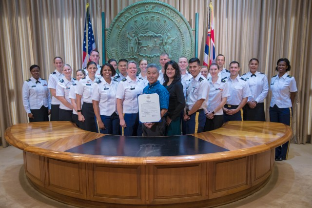 State of Hawai'i Governor David Ige presents a proclamation statement with staff members of the Tripler Army Medical Center Army Nurse Corps in support of the U.S. Army Nurse Corps' 117th Birthday and observance week, Jan. 26, 2018, at the State of Hawai'i Capitol Building, Honolulu, Hawai'i.