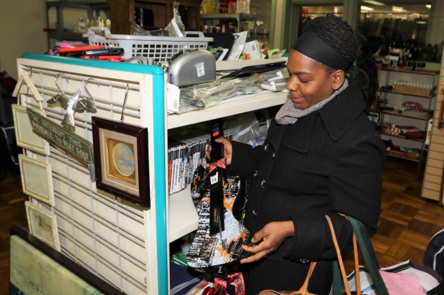 Chantal C. Alleyne, an Area IV spouse and native of Queens, New York, browses through used items at the Apple Tree Gift and Thrift Shop, Feb. 8 at Camp Walker, Daegu, Korea.