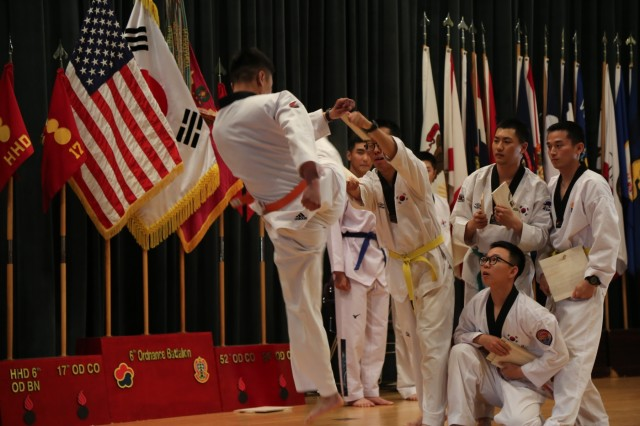 Korean Augmentation to the United States soldiers from Area IV demonstrate their taekwondo skills during the Asian American Pacific Islander Heritage Month observance in Camp Carroll, South Korea, May 4, 2017. The demonstrations showcased the rich cultural heritage that is a part of the lives of our strong and diverse military. (U.S. Army photo by Cpl. Sin, Jae Hyung, 19th ESC Public Affairs) 170504-A-SY896-086