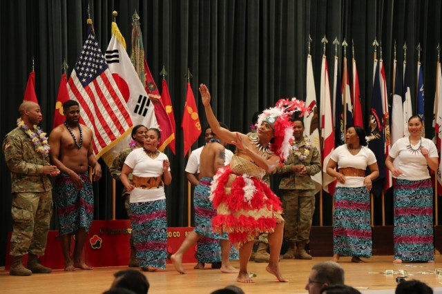 """Bullet Nation"" soldiers perform a traditional Samoan dance during the Asian American Pacific Islander Heritage Month observance in Camp Carroll, South Korea, May 4, 2017. The demonstrations showcased the rich cultural heritage that is a part of the lives of our strong and diverse military. (U.S. Army photo by Cpl. Sin, Jae Hyung, 19th ESC Public Affairs) 170504-A-SY896-179"