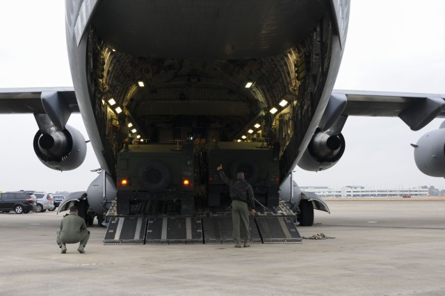 Loadmasters assigned to the 105th Airlift Squadron in New York unload a HUMVEE from a C-17 Globemaster III at the Combat Readiness Training Center for the PATRIOT South exercise, Gulfport, Miss., Feb. 10, 2018. Service members and local responders are preparing for PATRIOT South is a domestic operations disaster response training exercise conducted by National Guard units working in support of federal, state, and local emergency management agencies, and first responders.