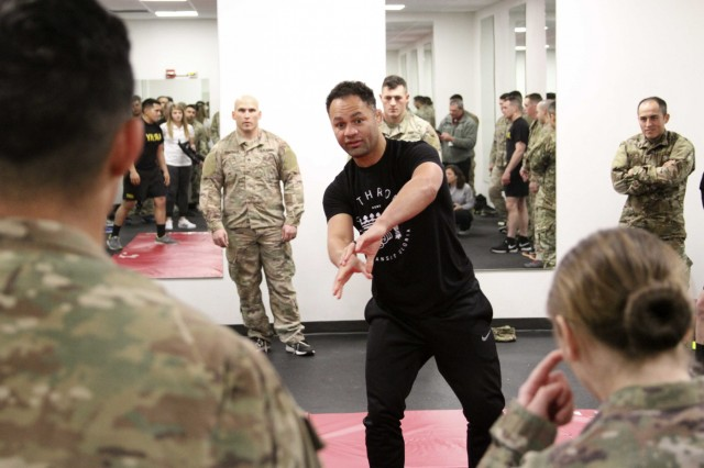 FORT HOOD, Texas- Retired, professional mixed martial arts fighter, Josh Koscheck, discusses close quarter combat techniques with Soldiers of 3rd Armored Brigade Combat Team, 1st Cavalry Division here Feb. 6. Koscheck taught Soldiers some basic grappling, takedown and submission moves while also teaching life lessons.