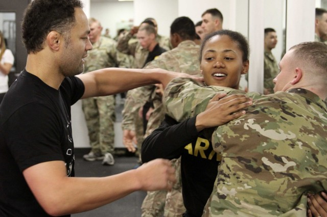 FORT HOOD, Texas- Retired, professional mixed martial arts fighter, Josh Koscheck, shares techniques with a Soldier from 3rd Armored Brigade Combat Team, 1st Cavalry Division here Feb. 6. Koscheck taught Soldiers some basic grappling, takedown and submission moves while also teaching life lessons.