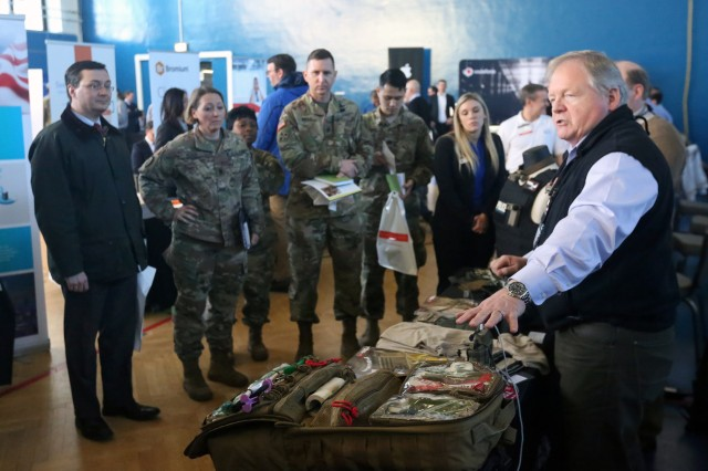 Bill Strang, an exhibitor with TSSi, gives a presentation to senior leaders during the U.S. Army Garrison Wiesbaden Tech Expo, Feb. 13, 2018 in the Tony Bass Gym on Clay Kaserne in Wiesbaden, Germany.