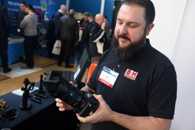 John Faison, an exhibitor with B&H, explains the features of a digital camera during the U.S. Army Garrison Wiesbaden Tech Expo, Feb. 13, 2018 in the Tony Bass Gym on Clay Kaserne in Wiesbaden, Germany.