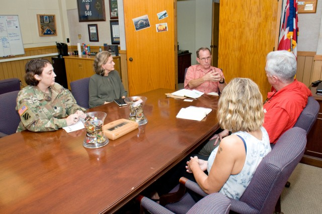 FORT SHAFTER - Lt. Col. Dawn Fick (left), chief of Human Resources Policy Division, Office of the Assistant Chief of Staff, G-1, U.S. Army-Pacific, Helen Gibson Ahn (green), a well-being specialist with USARPAC G-1, Pat Rice (in back), the deputy G1 for USARPAC, Ret. Col. Walter M. Herd, Army Transition Division director at the Human Resources Command Center of Excellence, and Sabrina Newman, Transition Services Specialist, Military Personnel Division (DHR) U.S. Army Garrison-Hawaii, discuss SFL-TAP at Fort Shafter, Feb. 2. Herd came to Hawaii, Feb. 1 and 2, visiting local SFL-TAP centers at Schofield Barracks and Fort Shafter, and meeting with Army leaders. Herd, who served in the Army for more than 20 years, took on his current position in 2010. Formerly, the Army Career and Alumni Program, the SFL-TAP offers services that assist participants as they prepare to reenter the civilian sector. (U.S. Army photo by Kristen Wong, Oahu Publications)