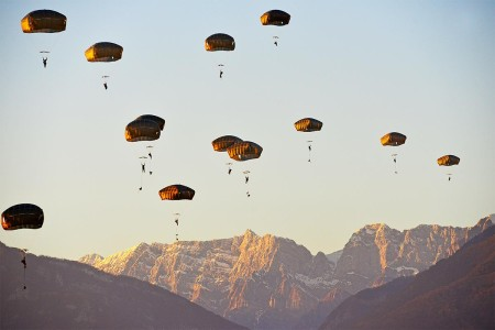 Paratroopers assigned to the 173rd Airborne Brigade, descend onto Juliet Drop Zone in Pordenone, Italy, during an airborne operation from a U.S. Air Force 86th Air Wing C-130 Hercules aircraft, Jan. 18, 2018.