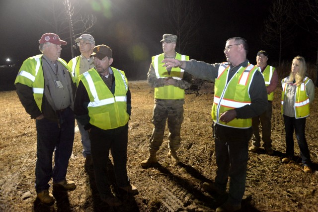 "John Lewis, third from right, describes a training site layout to Col. John Hurley, commander of the U.S. Army Engineering and Support Center, Huntsville, and Huntsville Center Program Director Albert ""Chip"" Marin, during the leaders' Jan. 11 visit to Redstone Arsenal. Accompanying them, from left to right, are Bill Sargent, director of Huntsville Center's Ordnance and Explosives Directorate; Roger Young, project manager with APTIM; Jason Watson, Redstone environmental site manager; and Ashley Roeske, project manager with Huntsville Center's Chemical/Biological Warfare Materiel Division. John Lewis, third from right, describes a training site layout to Col. John Hurley, commander of the U.S. Army Engineering and Support Center, Huntsville, and Huntsville Center Program Director Albert ""Chip"" Marin, during the leaders' Jan. 11 visit to Redstone Arsenal. Accompanying them, from left to right, are Bill Sargent, director of Huntsville Center's Ordnance and Explosives Directorate; Roger Young, project manager with APTIM; Jason Watson, Redstone environmental site manager; and Ashley Roeske, project manager with Huntsville Center's Chemical/Biological Warfare Materiel Division."