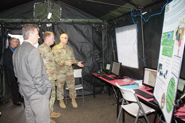 The Program Executive Officer for Aviation, Brig. Gen. Thomas Todd receives an overview of the latest Tactical Airspace Integration System from Sgt. First Class Eric Drabenstot.  The TAIS synchronizes the management of tactical airspace traffic control systems for Army missions and enables the safest operational environment for our Soldiers.