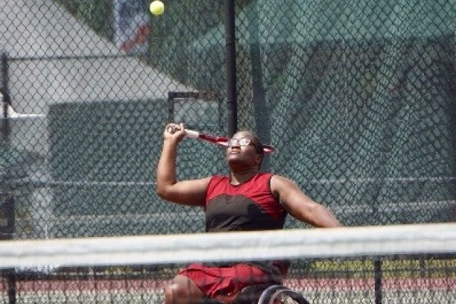 Dr. Lisa Maddox sets up for a serve while playing wheelchair tennis.