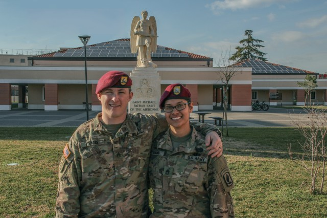 Staff Sergeants Zachary and Michelle Evans pose together outside the 173rd Airborne Brigade building for a photo after earning their Senior Jump Wings together.