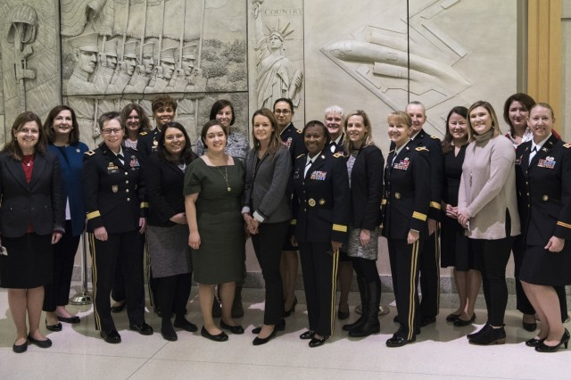 Female general officers and congressional staff delegates gather for a group photo after the Women Leadership Roundtable Discussion hosted at the Pentagon, Feb. 7, 2018. Top U.S. military generals met with congressional delegates to discuss their life perspectives as military women and the importance of having access to every talented American who can add strength to the force. (U.S. Army Reserve photo by Maj. Valerie Palacios)